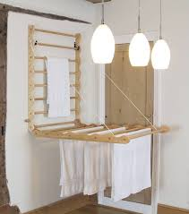 this clever diy laundry rack is the perfect solution in a small apartment space with limited
