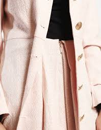picture of skirt styled trench coat