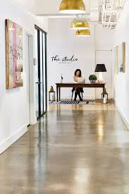 industrial office flooring. Bright Industrial Office Space With Gold Pendant Lights, Concrete Floors, And Large Art Flooring A