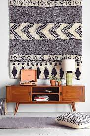 why stylists use rugs as wall hangings