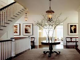 foyer decorating ideas with unique chandelier and round wood table small narrow front foyer decorating