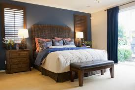 Elegant bedroom with blue accent wall.