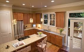 light granite countertops in brown cabinet kitchen