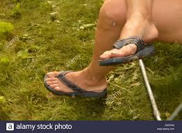 Dirty feet smoking outdoors