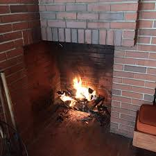 A fire in the library fireplace - Picture of Still Bend - Bernard Schwartz  House, Two Rivers - Tripadvisor