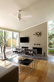 painted brick fireplace living room midcentury with light wood floors fireplace