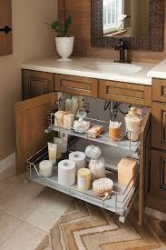 the unique u shape of this sink base cabinet slide out fits around plumbing by kitchen craft cabinetry
