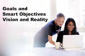 what is a marketing objective two women discussin the goals and objectives of their grant proposal