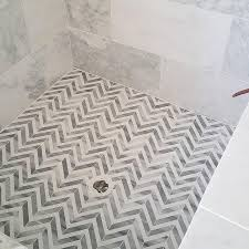Amazing shower features a marble surround alongside a white and gray marble  herringbone shower floor. Grey Tile ShowerSmall ...