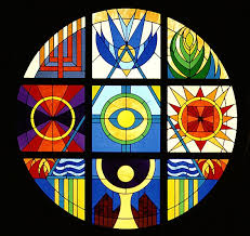 the large round stained glass window high above the altar and cross in the sanctuary was designed to be both decorative and symbolic