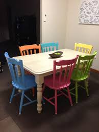 my freshly painted dining table with diffe coloured chairs a whitewash affect