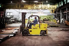 Man Driving Forklift In Warehouse Stock Photo Dissolve