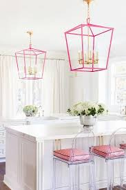 Laura Burleson Interiors - White and gold kitchen features white cabinets  paired with Silestone quartz countertops
