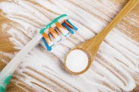 baking soda and toothbrush for natural teeth whitening