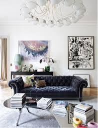 velvet sofa in dark blue via elle decor espana