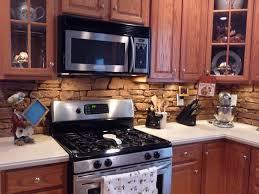 A DIY kitchen backsplash created with decorative stone panels