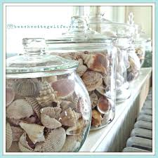 seaside decorating ideas coastal home decor s sea urchins sea glass collections in apothecaries on windowsill