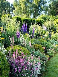 cottage garden plans. Unique Cottage This Once Formal Garden Has Been Turned Into A Cottage By Tucking  Flowers Between The Sculpted Shrubs And Cottage Garden Plans G