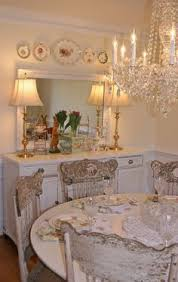 vine shabby cote dining room with chandelier