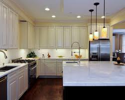 Inspiration For A Timeless L Shaped Kitchen Remodel In Chicago With An  Undermount Sink,