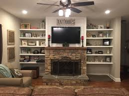 stacked rock fireplace barnwood mantel shiplap top with floating shelf built ins