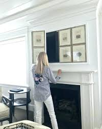 concealed tv above fireplace hiding