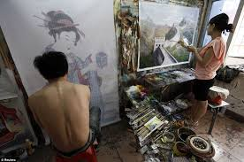 versatile painters work on two very diffe pictures one portrait of a anese geisha