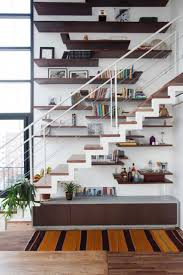 cool stairs decor of minimalist living room with modular shelves and under stair  cabinet