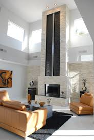 faux stone fireplace living room contemporary with accent lighting artwork black black fireplace black