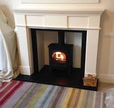 interior design intriguing regency wood burning stove with white carved fireplace mantle and wood burning