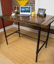 join the upcycle movement and learn how to repurpose a barn door into an adjule standing desk