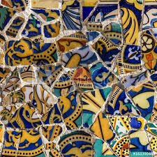 broken glass mosaic tile decoration in park guell barcelona spain designed by