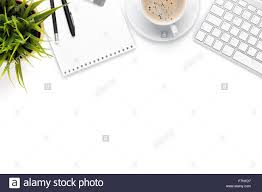top office table cup. Office Desk Table With Computer, Supplies, Coffee Cup And Flower. Isolated On White Background. Top View Copy Space O