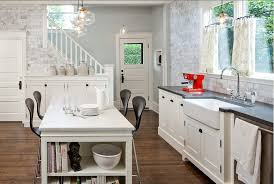 white french country kitchen with chandelier and dinning table also washbasin