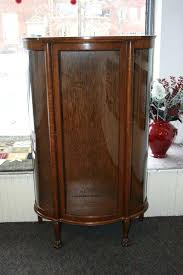 antique curio cabinet bent glass with desk