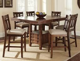 square dark brown wooden dining table with storage drawers eight chairs beige rug under round grey rugs sydney bedroom furniture brisbane machine washable