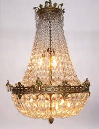a fine french 19th 20th century empire style gilt bronze and diamond cut crystal basket style nine light chandelier with fl trim and acanthus hooks