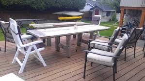 outdoor diy old and rustic long driftwood finish coffee table stained white chalk paint color for backyard patio with black and white wooden chairs ideas