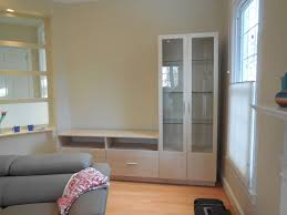 l shaped wall unit with glass doors