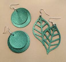 it is so fun and addictive and you can easily make ready made projects like these faux leather earrings in the cricut design space or design your own