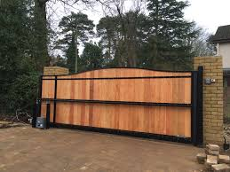 steel frame tracked sliding gate with t g infill rear