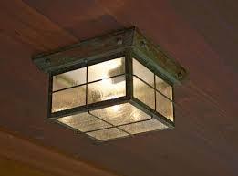 exterior ceiling light fixture. close up of tudor style flush exterior ceiling light in verdigris patina. fixture o