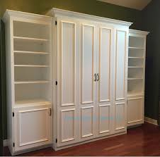 office beds. white painted mdf queen size murphy bed flat panel surface trimmed doors two bookcases office beds s