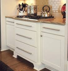 Drawers Or Cabinets In Kitchen White Shaker Cabinets With Slab Drawer Fronts Used To Create A