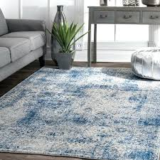 vintage distressed blue rug and gray couch