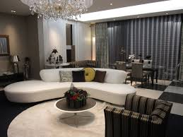 table floor home ceiling property living room room sofa apartment interior design design dining chandelier estate