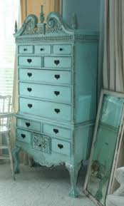 I love painted furniture... if the original wood can't be salvaged