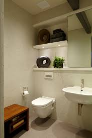 splashy duravit toilet in bathroom modern with wall hung toilet next to bathroom shelves alongside porcelain tile and wall mounted toilet