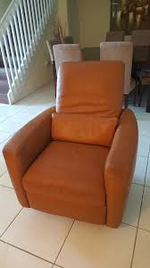 natuzzi genuine leather recliner and swivel chair camel color
