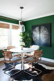 dining room like sarah sleek lines white walls colorful upholstery and warm wood tones and green walls